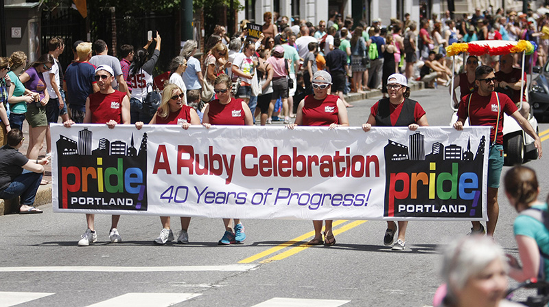 Portland Pride Parade heads down Congress Street in Portland Saturday. Jill Brady/Staff Photographer