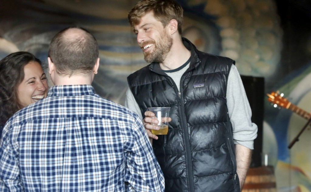 Stefan Apse of Portland visits with people at a social event at Urban Farm Fermentory in Portland. The gathering was hosted by Local Flames, a new Portland-based dating service that organizes events for singles, from paddling trips to mixology classes. Tim Greenway/Staff Photographer