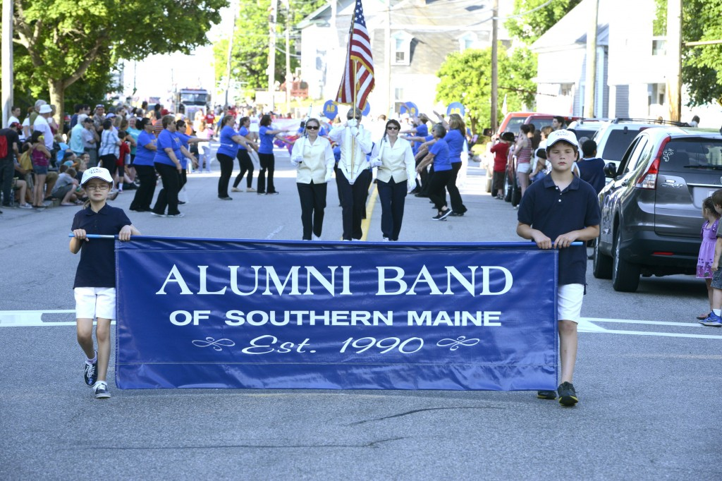 The Alumni Band performs during the La Kermesse parade along Alfred Street in Biddeford.