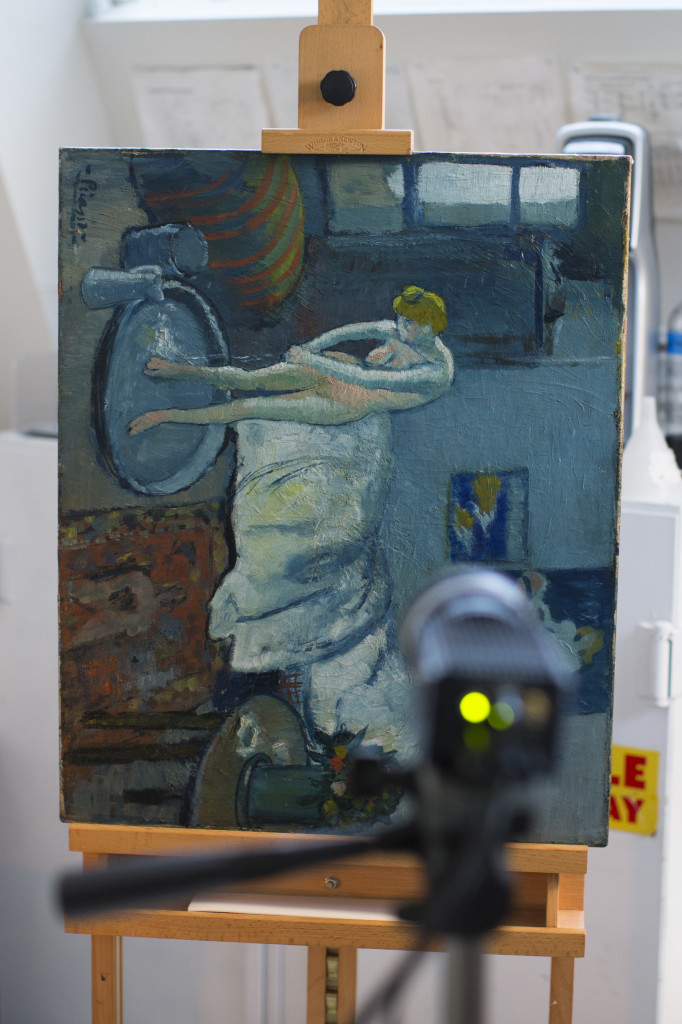 """""""The Blue Room,"""" one of Pablo Picasso's first masterpieces, sits in a vertical orientation in front of an infared camera at The Phillips Collection on June 10 in Washington. The Associated Press"""