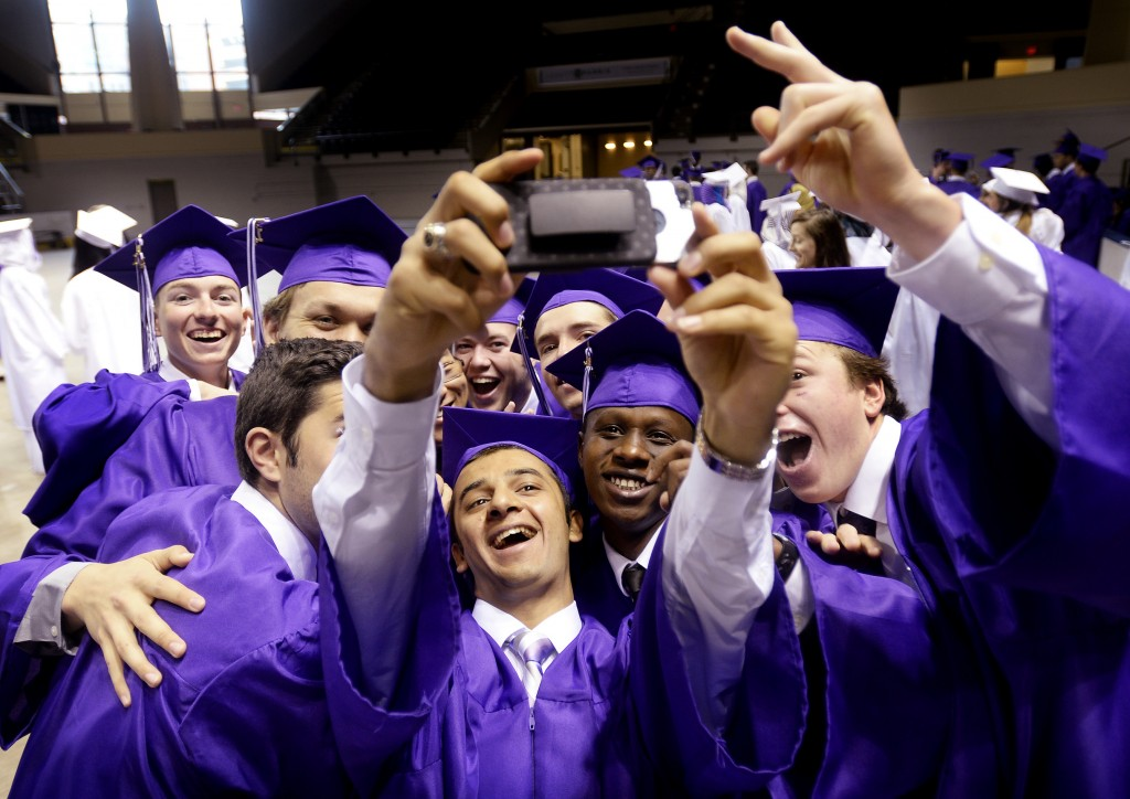 Thoalfakar Alsaady takes a selfie with some of his fellow classmates from Deering High School prior to graduation.