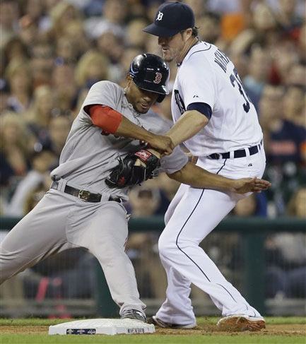 Red Sox third baseman Xander Bogaerts beats the tag of Tigers relief pitcher Joe Nathan as he steals third in  the ninth inning Saturday in Detroit. The Associated Press