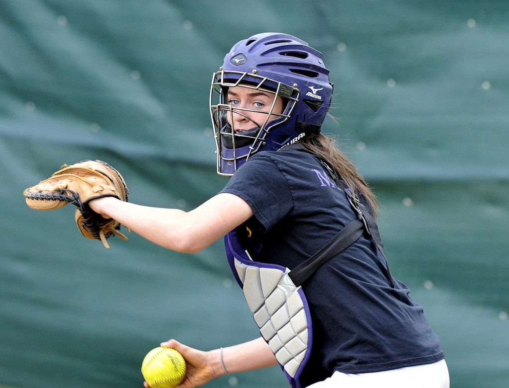 Margaret Rigney, a junior catcher who's playing softball for the first time since sixth grade, has been a key newcomer to Cheverus' lineup. John Patriquin/Staff Photographer
