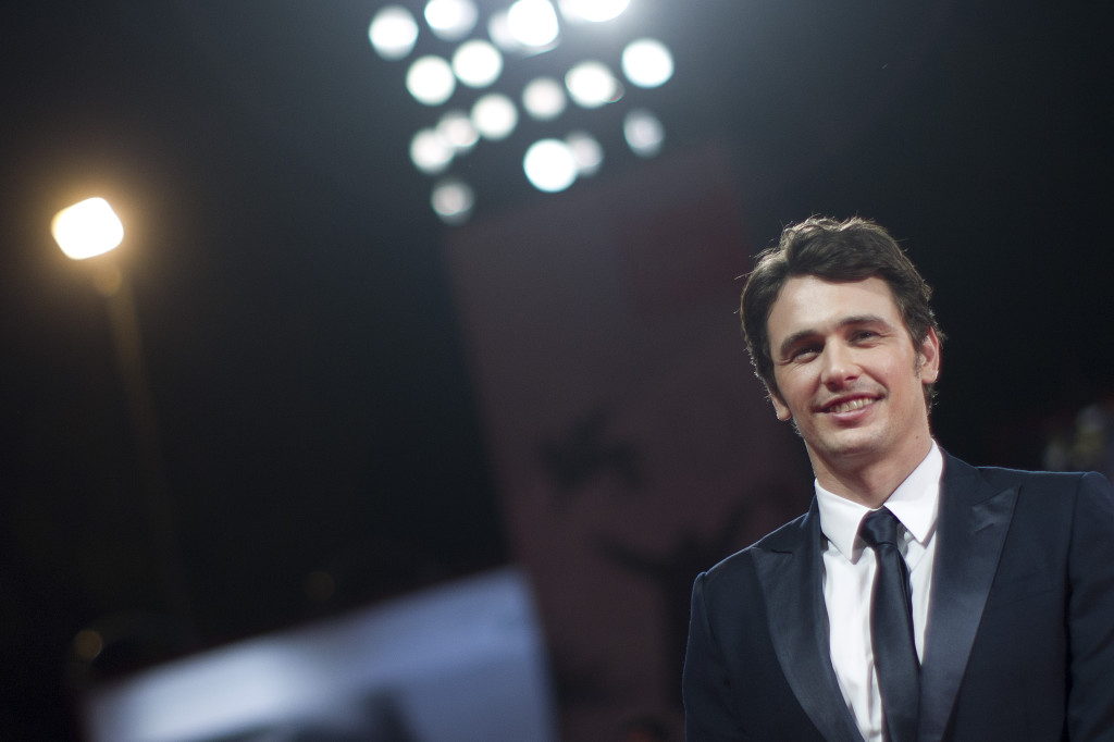 James Franco poses for photographers on the red carpet for the screening of the film
