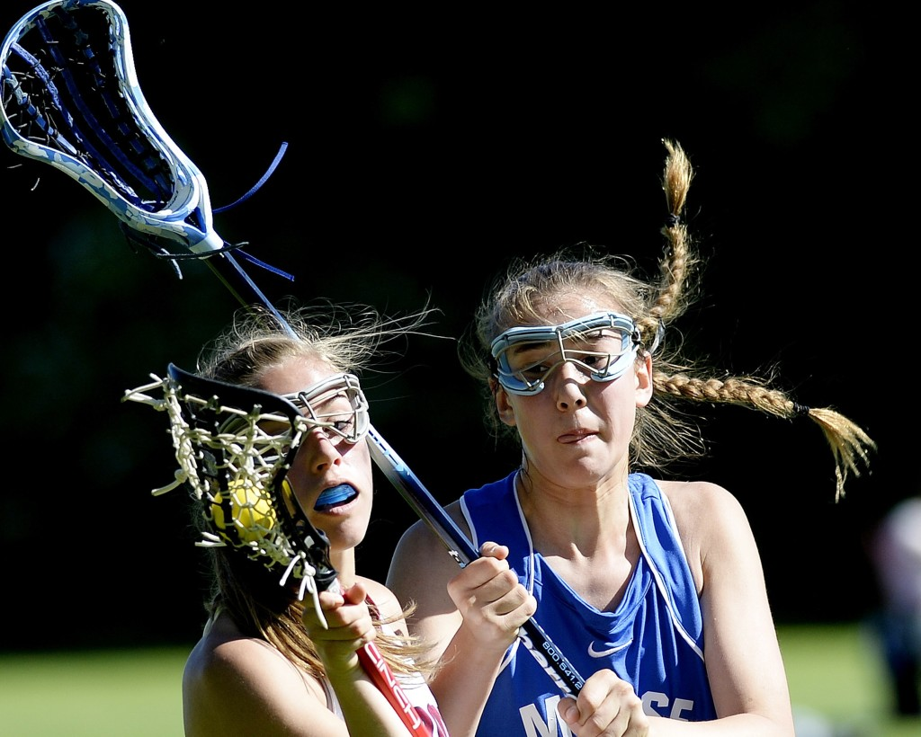 Freeport's Courtney Broderick tries to keep the ball from Noa Sreden of Morse in girls lacrosse action Monday.