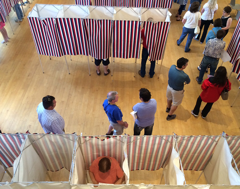 In this file photo voters line up to have their ballots scanned in Kennebunk town hall. Gregory Rec/Staff Photographer