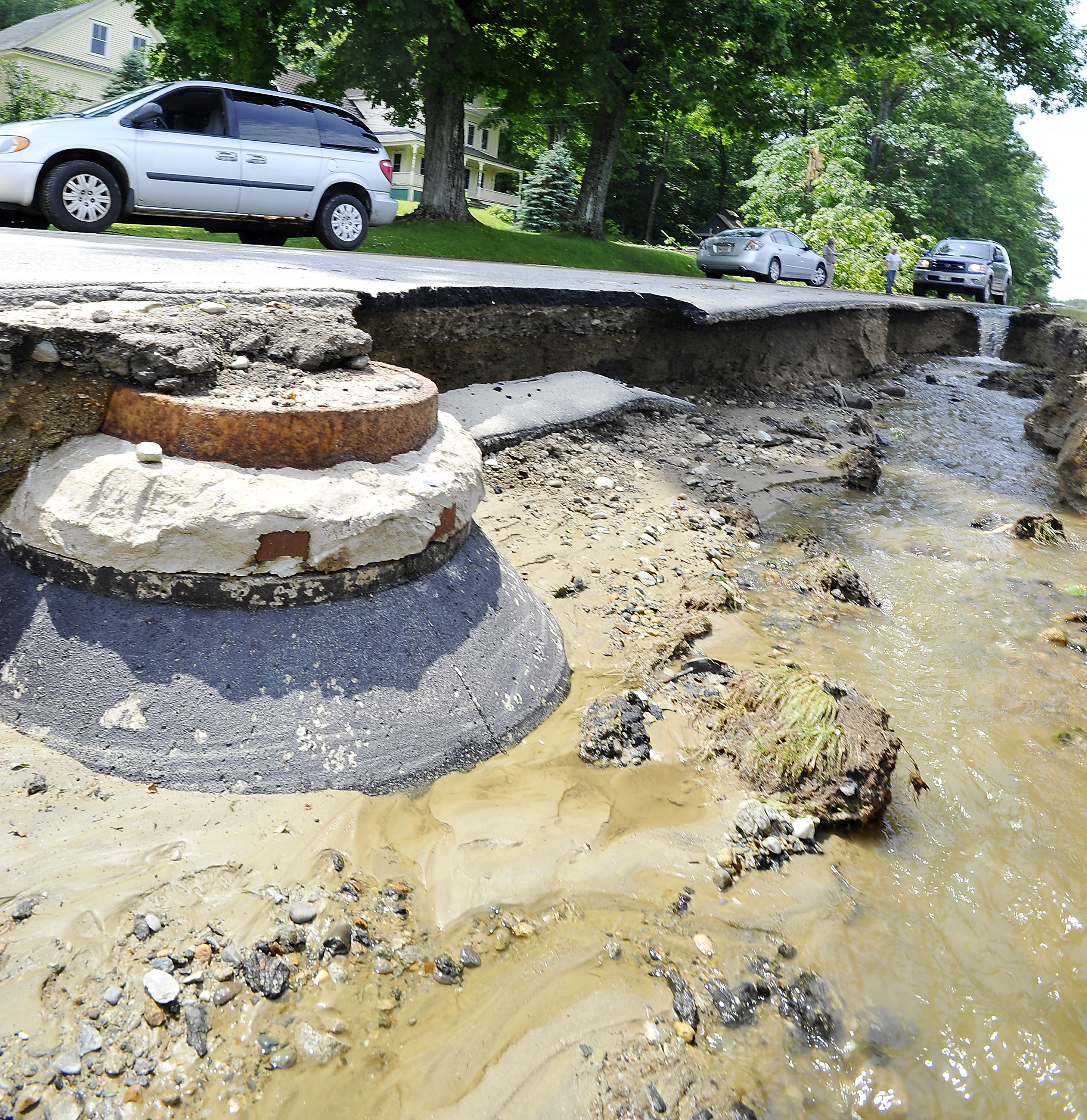 Wyman Hill Road was washed out by Wednesday's storms. Cars could pass only on one side Thursday.