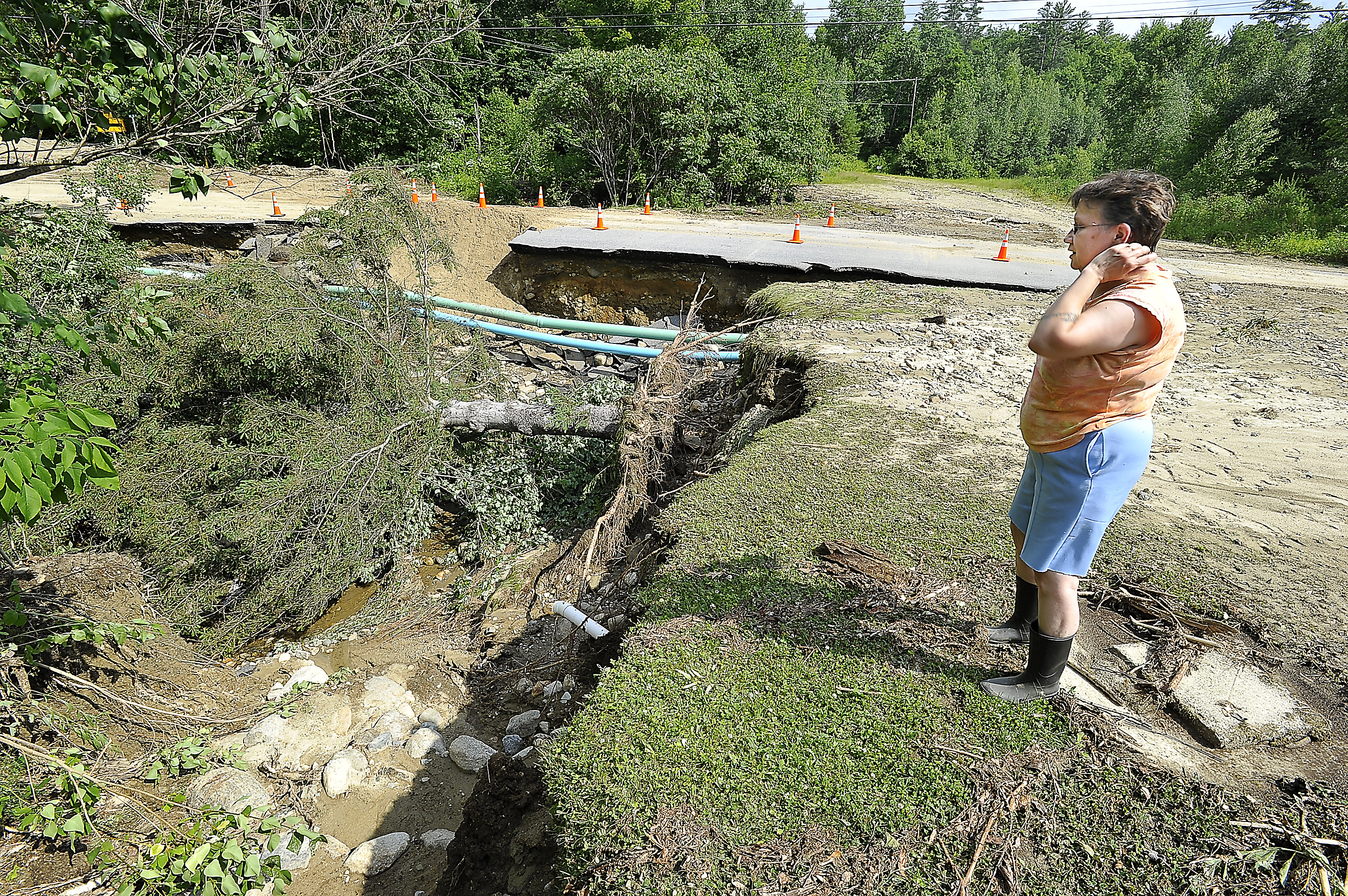 Stephenie Ackerman of South Rumford Road in Rumford checks out the damage to her yard after heavy storms passed through Wednesday night.