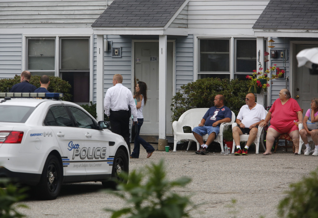 Investigators talk with residents of River View apartments in Saco where five bodies were found Sunday afternoon. Derek Davis/Staff Photographer