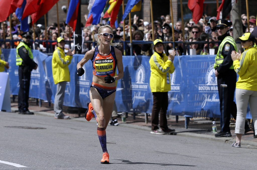 Shalane Flanagan approaches the finish line to finish fourth in the women's division of the 2013 Boston Marathon. The Associated Press