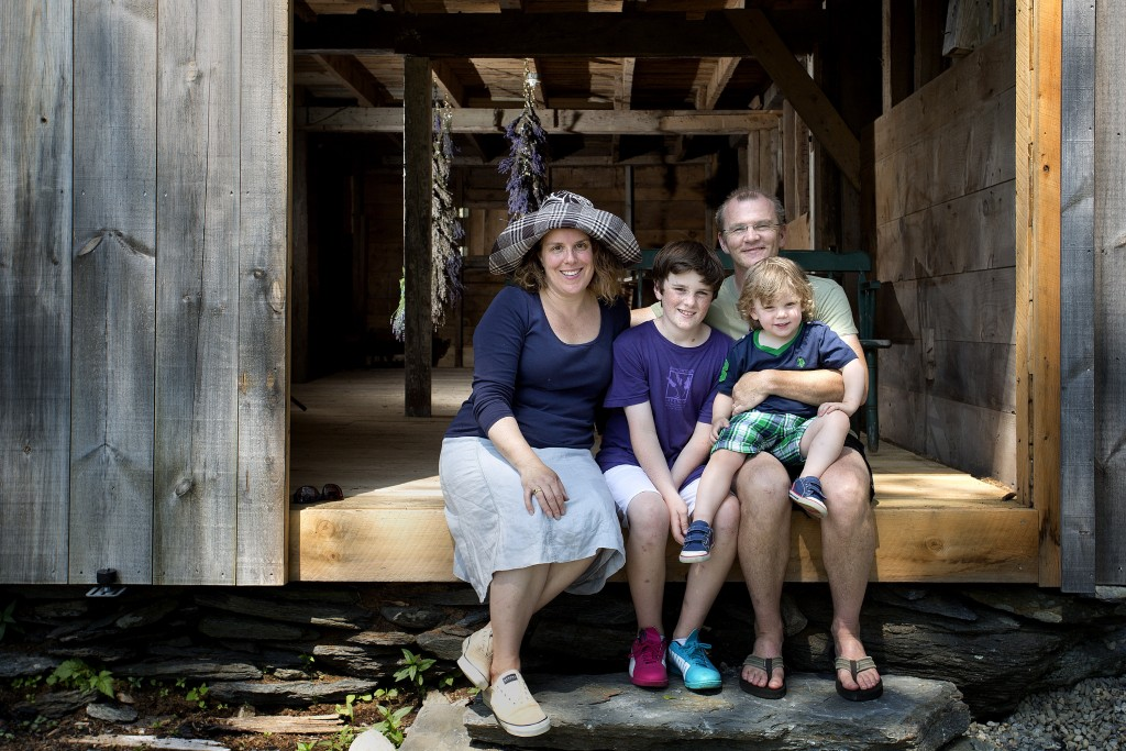 Lorie Costigan poses for a portrait with her family, sons Hugh and Dez, and her husband, Patrick, on July 2 at their Glendarragh Lavender Farm in Appleton.