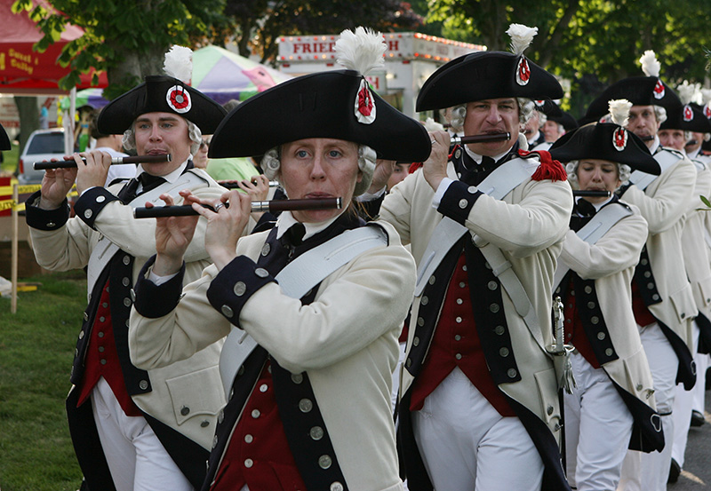 Members of the Middlesex County Volunteers Fifes and Drums march Saturday, July 5, 2014 heading for July 4th celebration on the Eastern Promenade in Portland, Maine. The fireworks were postponed a day due to weather.  Page/Staff Photographer