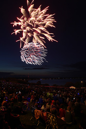 Spectators watch the fireworks display Saturday, July 5, 2014 along the Eastern Promenade in Portland, Maine. The fireworks were postponed a day due to weather. Joel Page/Staff Photographer