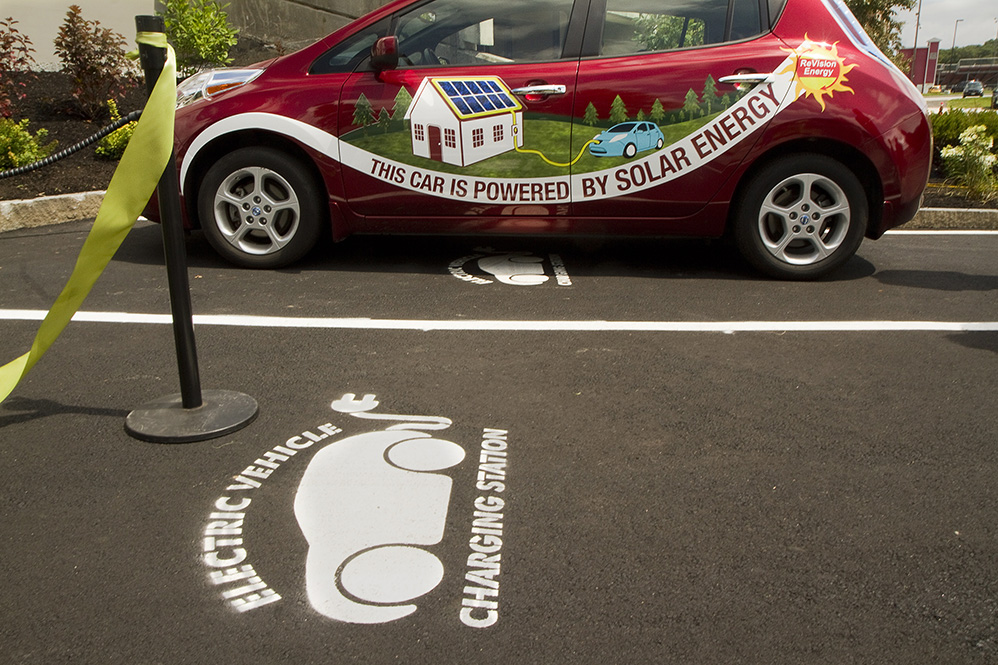 An electric car powers up Thursday at the new quick-charge station near the South Portland Community Center. A CMP program is providing electric cars to colleges, local governments and businesses and installing charging stations throughout the state. Carl D. Walsh/Staff Photographer