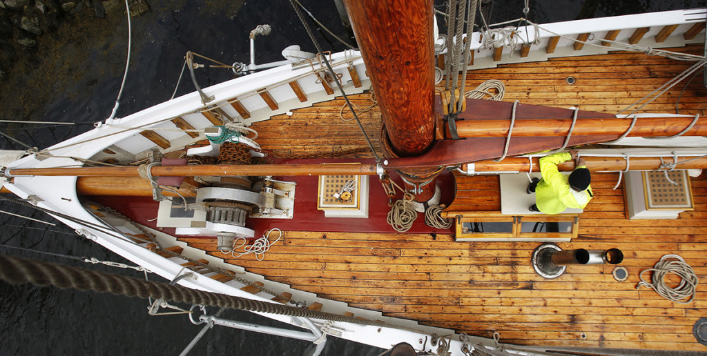 Fabrizio fastens the main sail while preparing the schooner for the sailing season.