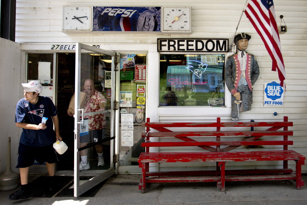 "Customers leave the Freedom General Store in Freedom on the afternoon of Monday, June 30, 2014. The store is known as the ""hang out"" in town, and proudly displays its patriotism, from the cardboard cutout of a soldier to the American flag at right."
