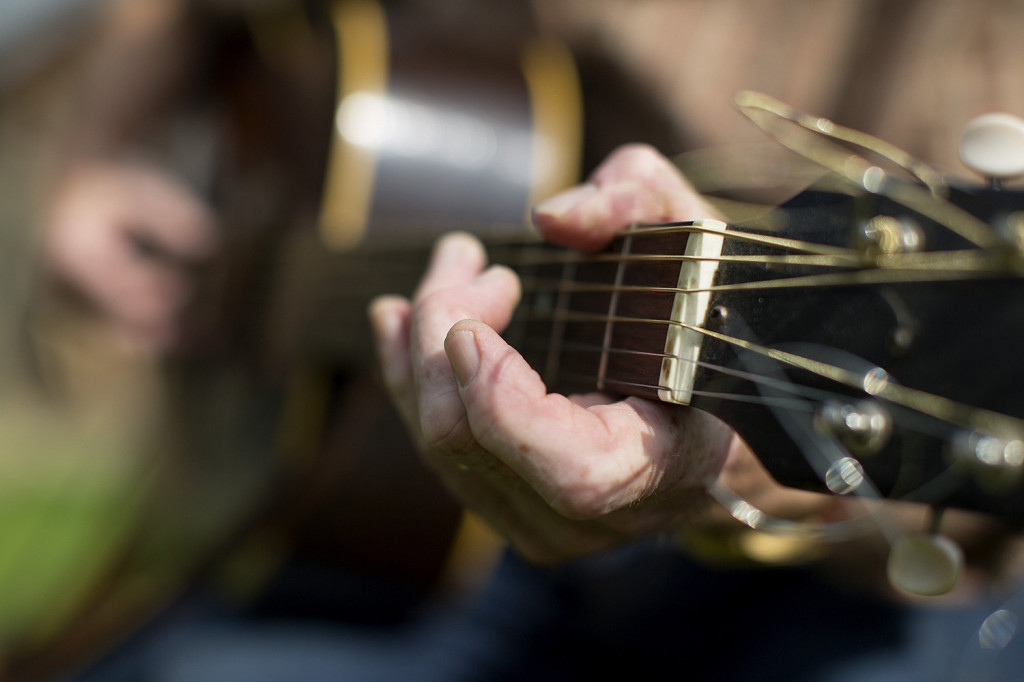 Mallett plays his guitar at his home in Sebec.