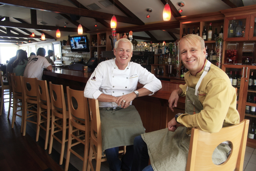 Mark Gaier, left, and Clark Frasier inside their MC Perkins Cove. They opened M.C. Spiedo in the Renaissance Boston Waterfront Hotel in February.