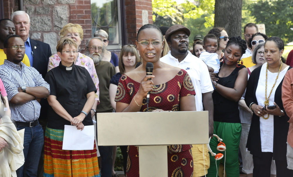 Suavis Furaha, an asylum seeker from Burundi, speaks out against General Assistance cuts at a news conference last week. The emergency aid helped her move her family out of a shelter, the Westbrook mother of four said.