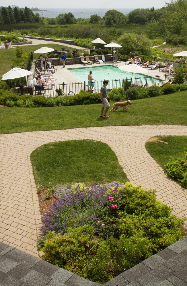 Guests at the Inn by the Sea relax by the pool. Carl D. Walsh/Staff Photographer