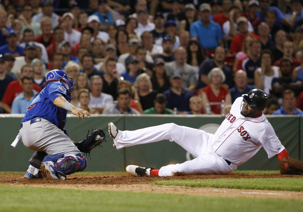 Cubs catcher Welington Castillo applies the tag as Red Sox designated hitter David Ortiz is out trying to score on a fielder's choice grounder by Xander Bogaerts in the sixth inning.