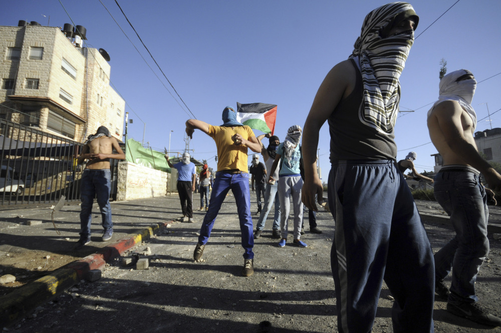 Palestinians throw stones during clashes with Israeli security forces in Jerusalem on Thursday. The violence erupted Wednesday after 16-year-old Palestinian Mohammed Abu Khdeir was abducted and killed. His family believes extremist Israelis killed him in revenge for the deaths of three Israeli teenagers.