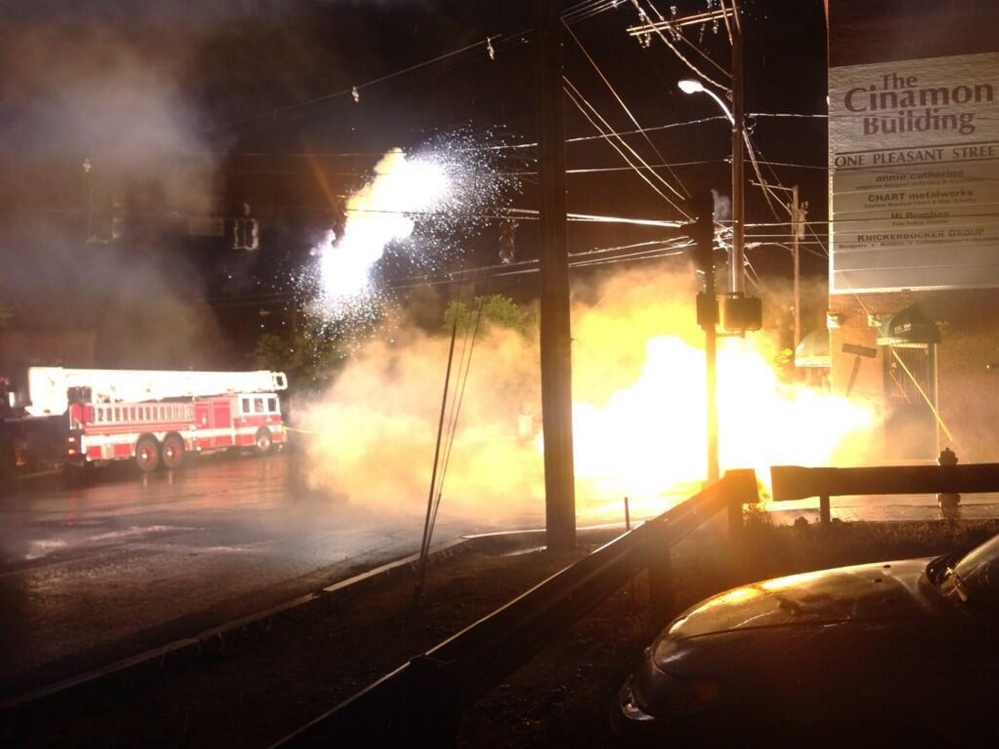 A photo by WCSH6 shows wires sparking and flames shooting from equipment after a power line catches fire in downtown Portland on Thursday night.