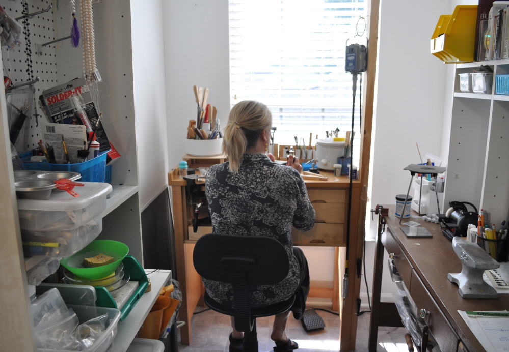 """Amanda Carroll runs her online business from her home studio in Concord, N.C. """"My store schedule was 24/7. Nine a.m. to 8 p.m. was my day at the store. Here, I just have a nicer routine. I include regular breaks from being hunched over something. I make time to meditate,"""" she says."""
