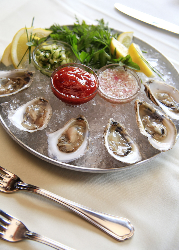 Anneke Jans' Little Bay oysters appetizer is served with a trio of sauces.