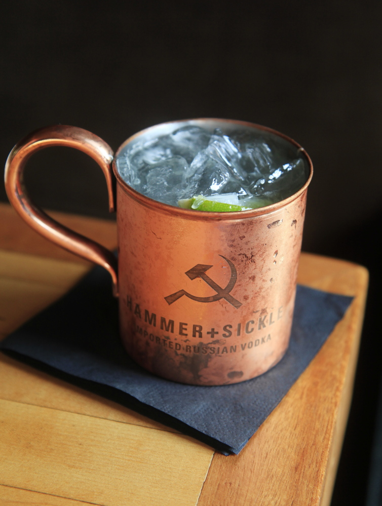 A Moscow Mule, made with ginger beer, fresh-squeezed lime juice and Hammer + Sickle imported Russian vodka and served in a copper cup.