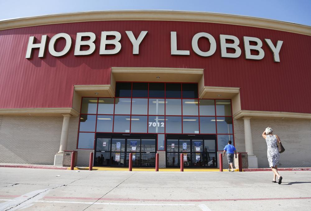 Customers walk into a Hobby Lobby store in Oklahoma City.