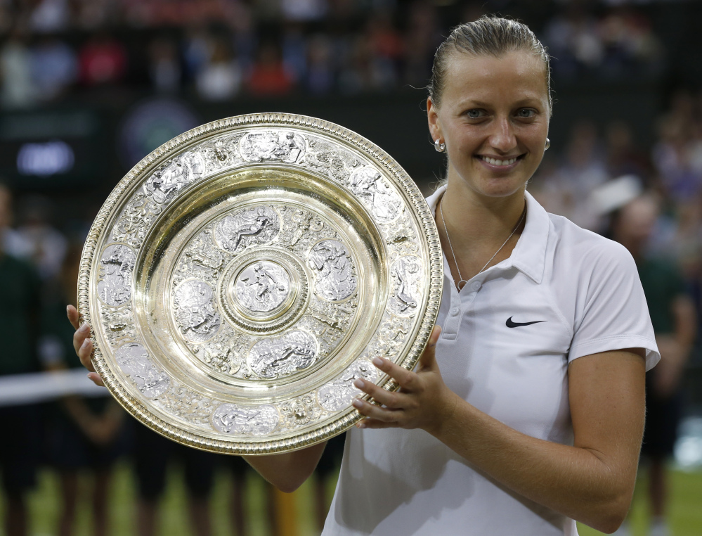 Petra Kvitova holds the  trophy after winning the women's singles final against Eugenie Bouchard on Saturday in Wimbledon.