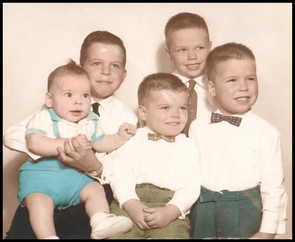 The Michaud siblings. Back Row:  Jim holding Rob, Mike standing in back with regular tie, and front row from left, Terry and Jerry (in bow ties). Courtesy photo