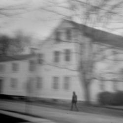 """A woman walks past the Eastport house that Don Gellers called home when he represented the Passamaquoddys in the 1960s. Gellers was arrested here in 1968, right after filing a $150 million land claims suit for the tribe, on charges of """"constructive possession"""" of marijuana cigarettes."""