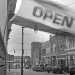 """An """"open"""" flag flies above a storefront in Eastport, not far from where the Passamaquoddy's attorney Don Gellers had his office in the early 1960s, before his former legal intern, Tom Tureen, took over as the tribe's representative in the Indian land claims lawsuit."""