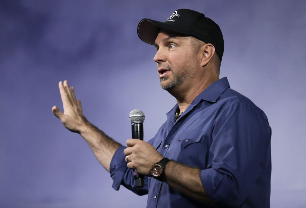 """Country music star Garth Brooks speaks at a news conference on Thursday in Nashville. """"If the prime minister himself wants to talk to me I will crawl, swim, I will fly over there this weekend, sit in front of him."""" he says."""