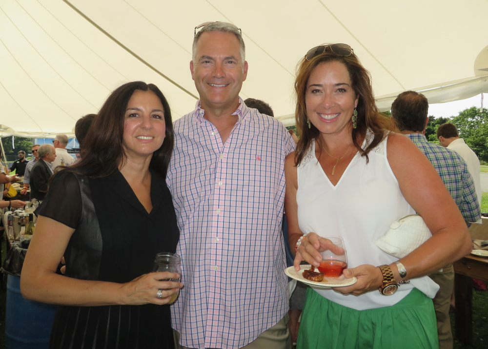 Melissa and Ed McKersie of Portland and Dana Woodbury of Falmouth at the Taste of the Nation VIP reception to battle child hunger in Maine.  Photo by Amy Paradysz