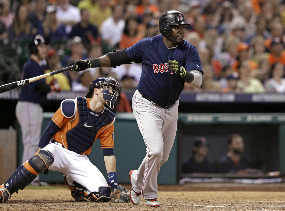 Boston's David Ortiz heads up the first base line on a three-run, bases-loaded double in the sixth inning Friday night in Houston.