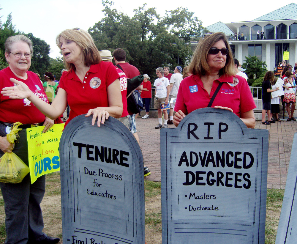 Demonstrators gather outside the North Carolina General Assembly in Raleigh last summer to protest the elimination of tenure and extra pay for teachers with advanced degrees in the state.