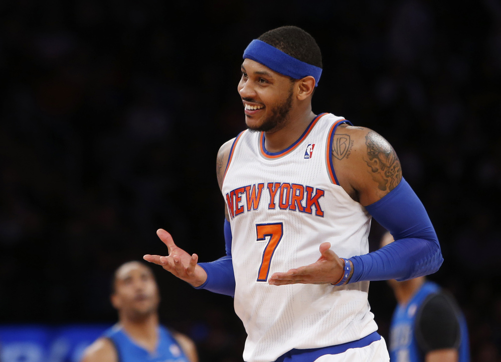"""Carmelo Anthony is remaining with the Knicks, saying he wants """"to stay and build here with this city and my team."""" Anthony made his decision official Sunday with a posting on his website. He writes: """"In the end, I am a New York Knick at heart."""""""