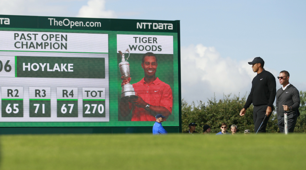 Tiger Woods walks onto the 12th green during his practice round Tuesday for the British Open, which starts Thursday at the Royal Liverpool golf club, where he won in 2006.