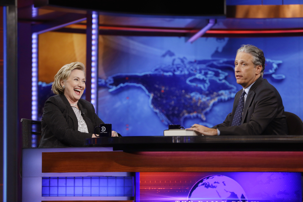 """Former U.S. Secretary of State Hillary Rodham Clinton reacts to host Jon Stewart during a taping of """"The Daily Show with Jon Stewart,"""" Tuesday in New York"""