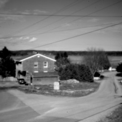 The Pleasant Point reservation is captured in the aperture of a pinhole camera. A legal challenge resulted after an unusual Passamaquoddy caucus initiative in 1986 left many members of the tribe stripped of their right to vote on tribal matters.