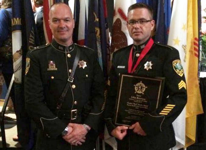 Kennebec County Sheriff Randall Liberty stands with Sgt. John Bourque following the awards ceremony last month in Texas.