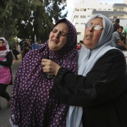 """The mother, left, of Fullah Tariq Shahebar, 8, one of three children who were killed in an Israeli missile strike, grieves after identifying her daughter at the hospital's morgue in Gaza City on Thursday. A State Department spokeswoman said, """"Israel must take every possible step to meet its standards for protecting civilians from being killed."""""""