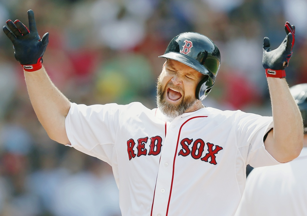 Red Sox catcher David Ross celebrates his two-run home run in the fourth inning against the Kansas City Royals in Boston on Sunday.