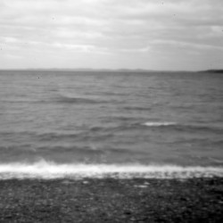 """With Deer Island in New Brunswick on the horizon, the ocean waters of Passamaquoddy Bay lap against the shore at Pleasant Point. At Indian Township, Gov. Bobby Newell says he """"got caught in the political crossfire by ambitious people"""" who wanted his job."""
