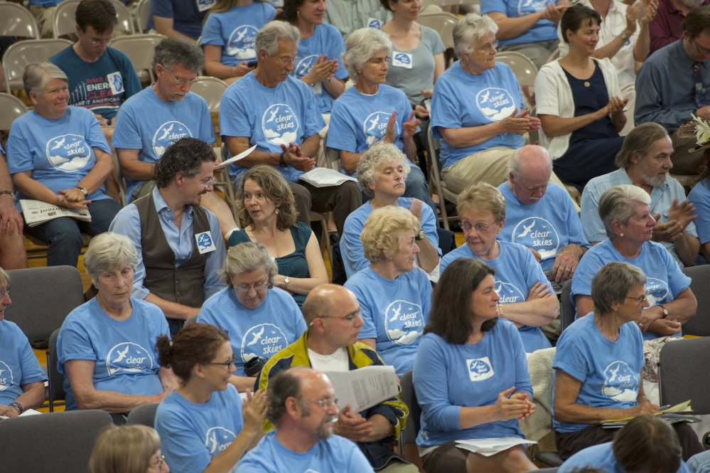 Citizens in favor of the ban to keep tar sand oil from entering the harbor in South Portland wear blue shirts  during the South Portland City Council meeting Monday.  Logan Werlinger/Staff Photographer