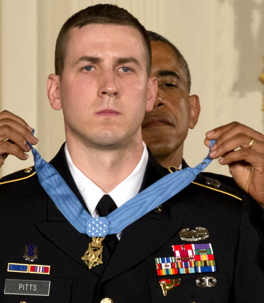 President Obama bestows former Army Staff Sgt. Ryan Pitts with the Medal of Honor in the East Room of the White House on Monday.