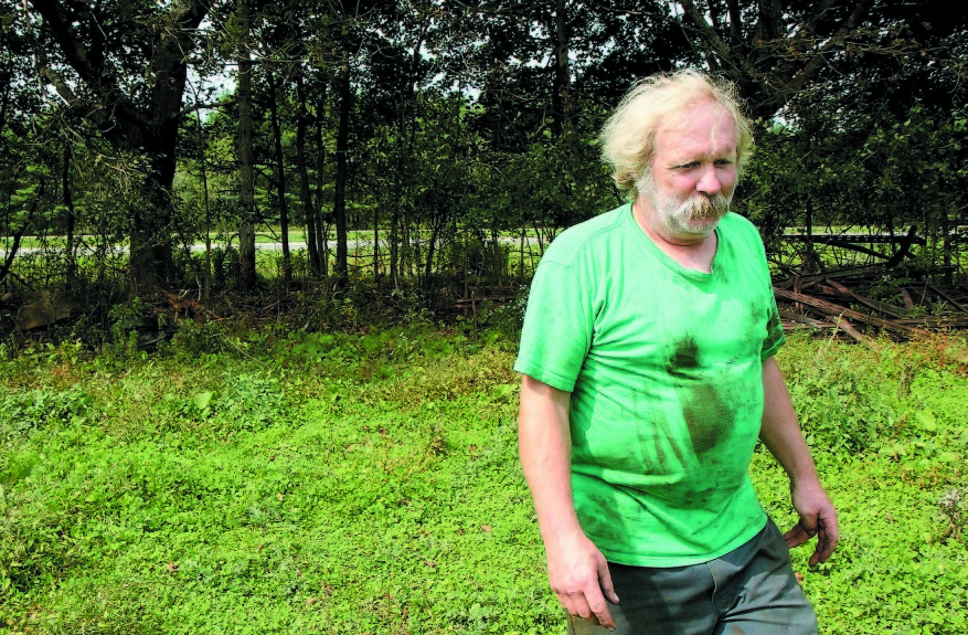 Farmer Mark Gould, seen in this 2011 photo, owns property that abuts Interstate 95 in Sidney.